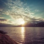 sunset over mountains with water kootenay lake
